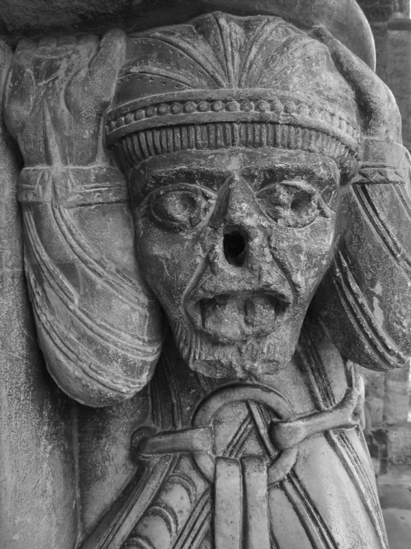 Atlantes figures supporting the Romanesque portico of the Eglise Ste Marie, Oloron-Ste Marie, France