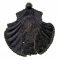 Pilgrim badge from the shrine of St James in Santiago de Compostela in north-west Spain. This badge is in the shape of a scallop shell. In the centre of the shell is a standing figure of St James dressed as a pilgrim with a cloak, a satchel and holding a staff. He has a large nimbus (halo) around his head. The edge of badge is beaded.